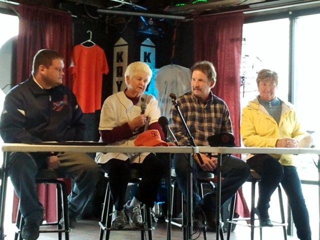 Representatives of the Rockford Aviators, Rockford Starfires, and Rockford Park District join Rockford Peach Helen Wyatt at new team announcement.