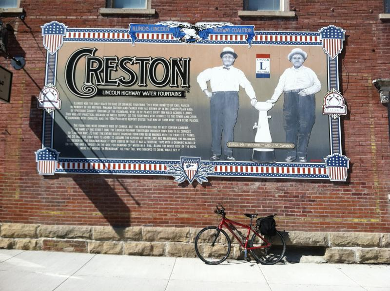 The bike takes a break under Creston's Lincoln Highway mural.
