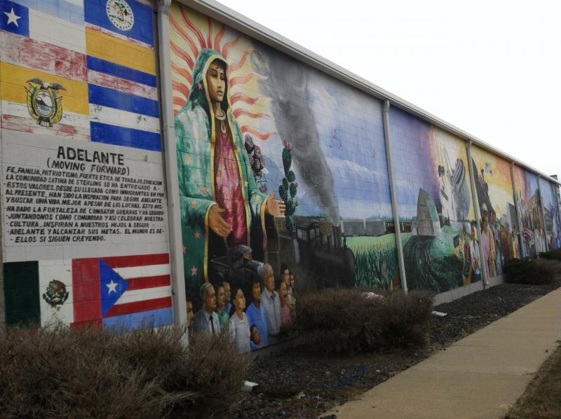 Also in Sterling: Hispanic American themes including patriotism and family, against the familiar northern Illinois backdrop of trains and corn fields.