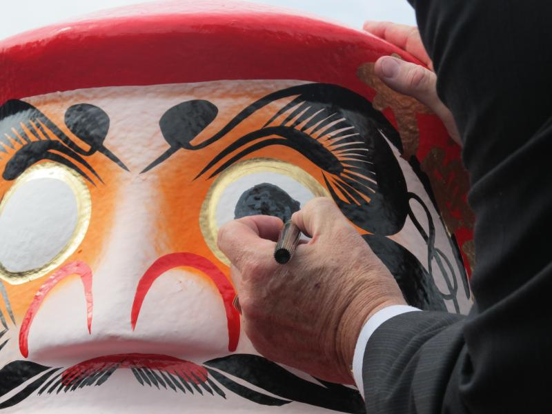 Daruma doll, a popular Japanese talisman of good luck for the start of the project in Rochelle