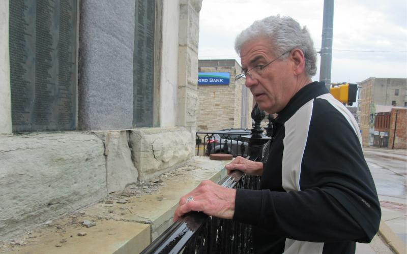 Ron Werntz assesses damage on the Civil War monument in Freeport