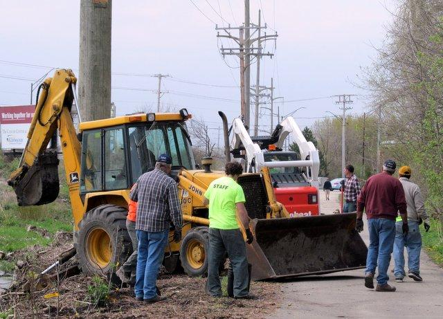 A lot of workers and some heavy equipment made it possible for more than 400 plantings along the DeKalb Nature Trail in just a few hours.