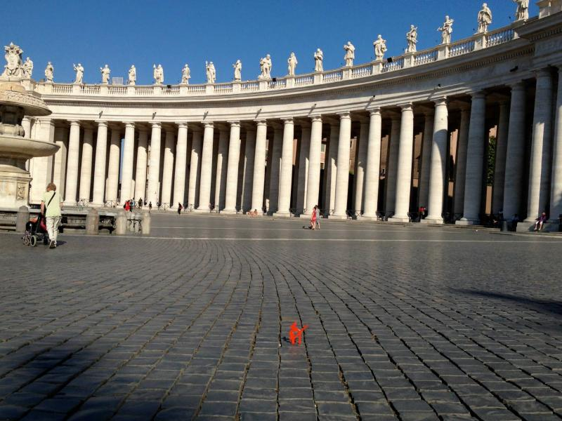 Symbol is dwarfed during a visit to Piazza san Pietro