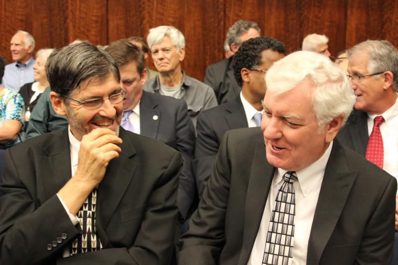 An economist (Ron Baiman, with the Chicago Political Economy Group) speaks with Southern Illinois University President Glenn Poshard in advance of a pension hearing