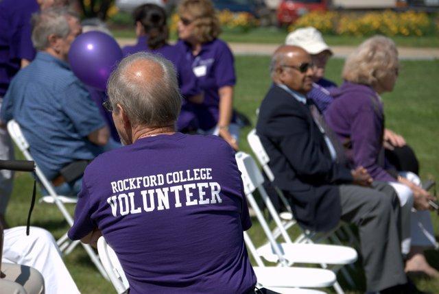 A purple-clad volunteer for the Rockford University celebration Monday.