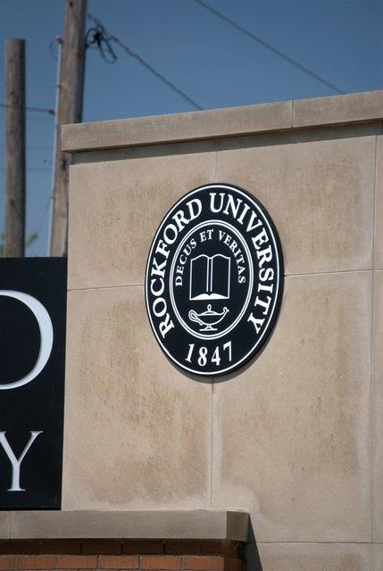 The university seal with the new designation.