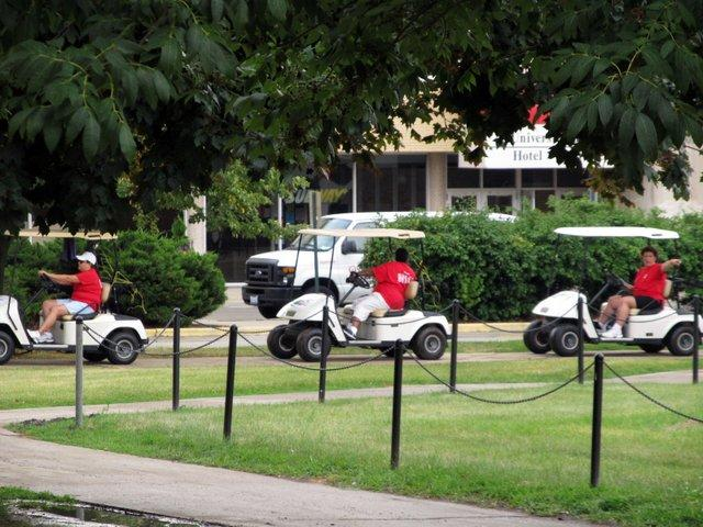 A trio of cart-driving helpers line up to offer their services on NIU move-in day