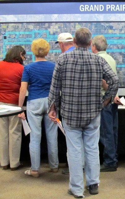 Rochelle-area residents line up to see how they will be affected by ComEd's transmission line plan.