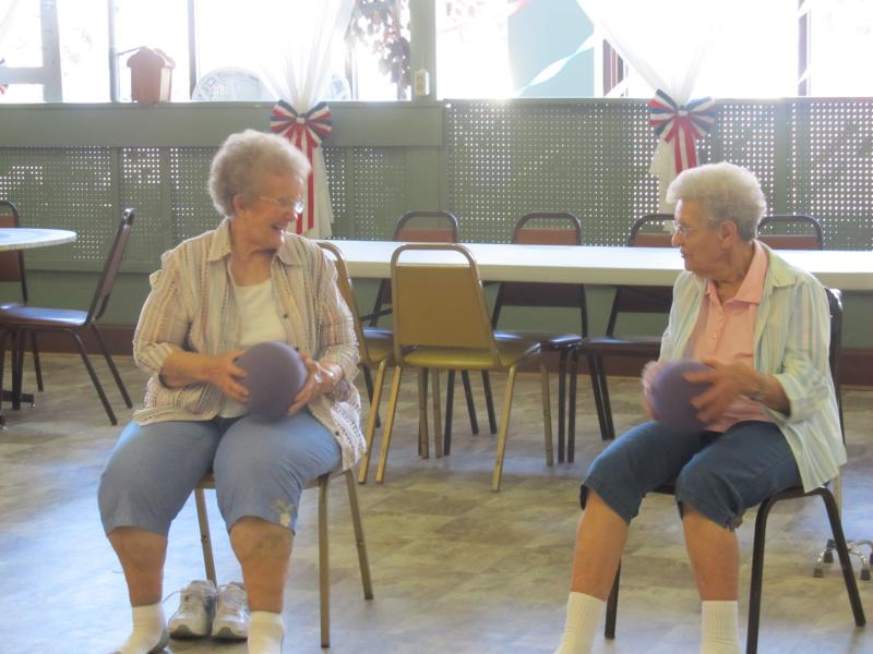 participants take part in an exercise class at the Polo Senior Center