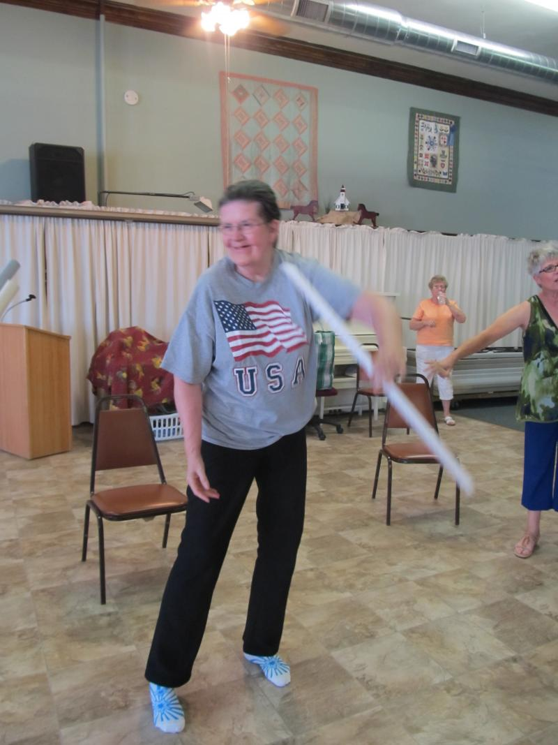 A Fit For Life participant twirls an exercise cane like a baton