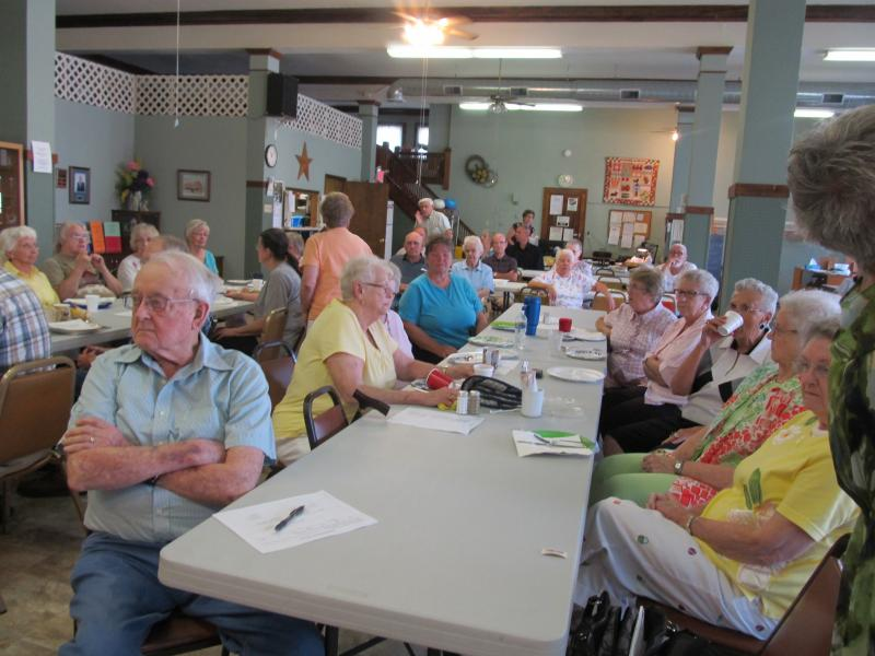 Seniors gather for a potluck at the Polo Senior Center