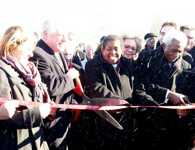 IDOT's Ann Schneider, Governor Pat Quinn, Venita Hervey, and Victory Bell cut the ribbon on the Morgan Street Bridge