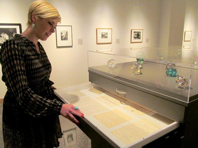 RAM Curator Carrie Johnson Breitbach looks over some of the historic letters she's made available to the public in the museum's centennial exhibit.