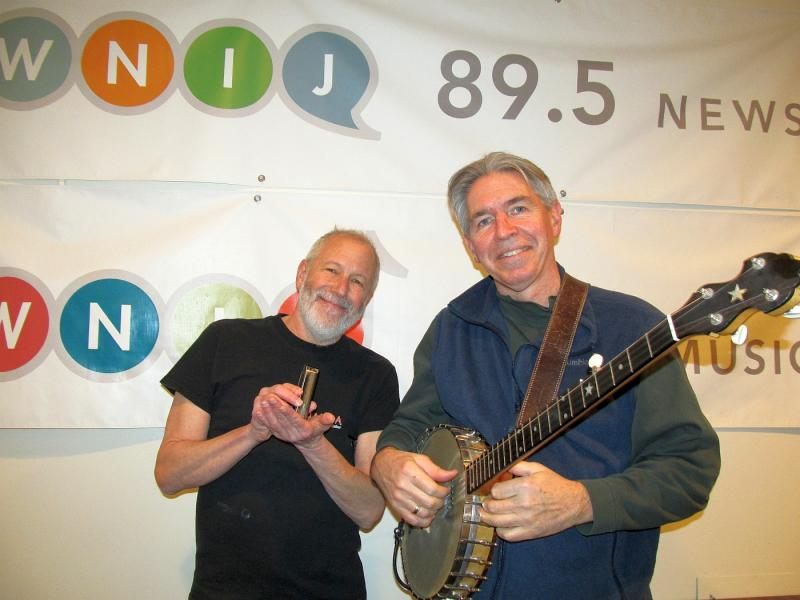 Corky  and Mike in front of the WNIJ/WNIU banner