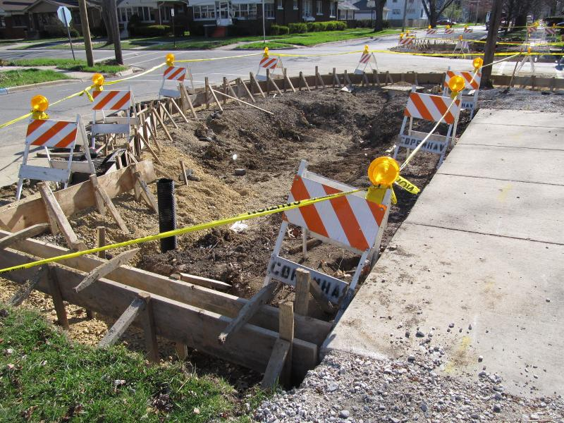 At another site along Simms, wood forms for new curbs stand ready for concrete to be poured. Note the bump-out shape, meant to calm traffic