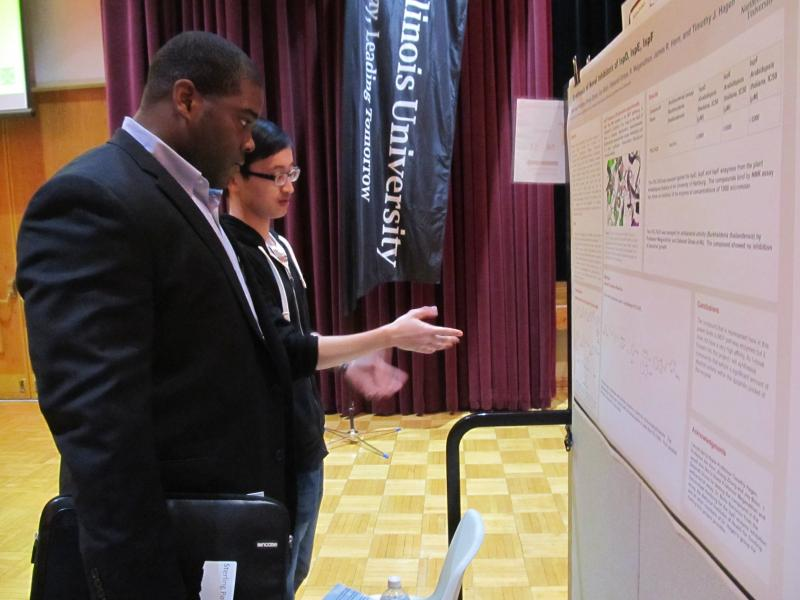 Sterling Pollard and Zheng Zhang go over their research at the Holmes Student Center