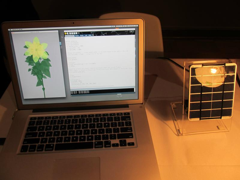 Philip Pellicore's demonstration of a solar panel that creates a simulated flower using a JAVA-based program to teach young students about solar energy