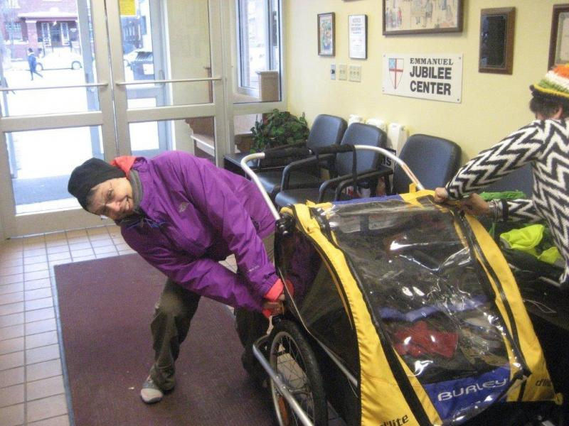 Deaconess Lou Ness checks her cart Tuesday morning before leaving Rockford for her walk to Washington, D.C.