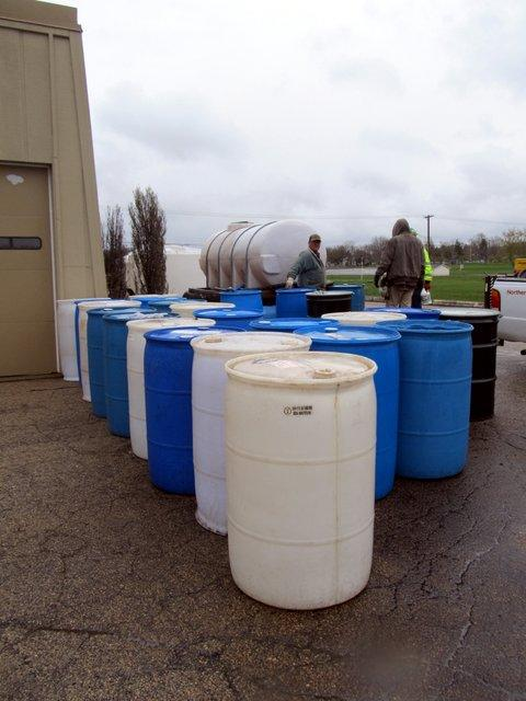 Barrels lined up behind Northern Public Radio's studios to collect contaminated water.