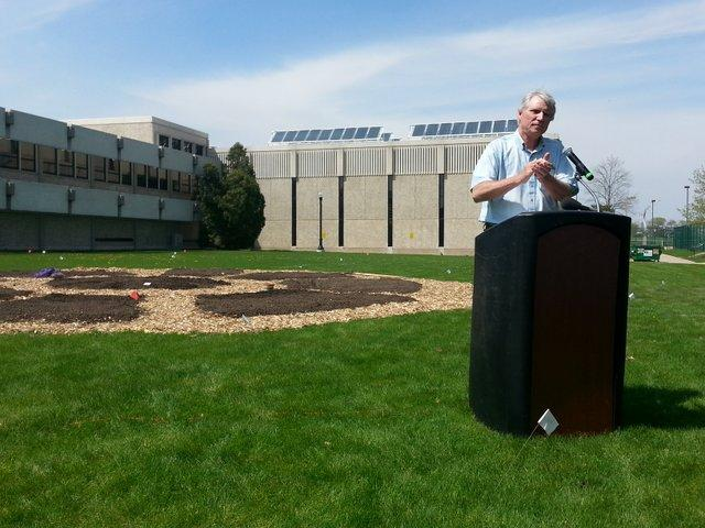 DCCG president Dan Kenney kicks off the first planting at the new International Garden at NIU