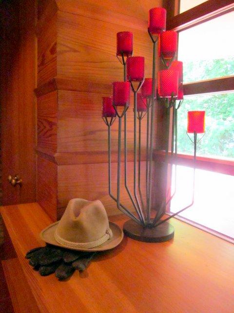 Kenneth Laurent's hat and gloves in the spot he always placed them in his Frank Lloyd Wright-designed home.