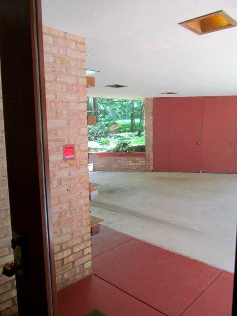Looking out the front door: note the Frank Lloyd Wright red nameplate in the brick.