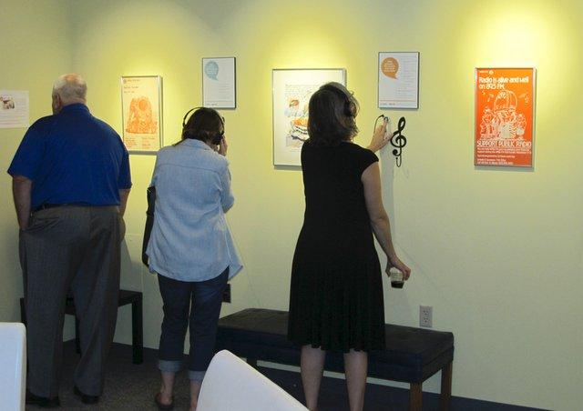 Visitors check out a range of audio stories from WNIJ's news department.