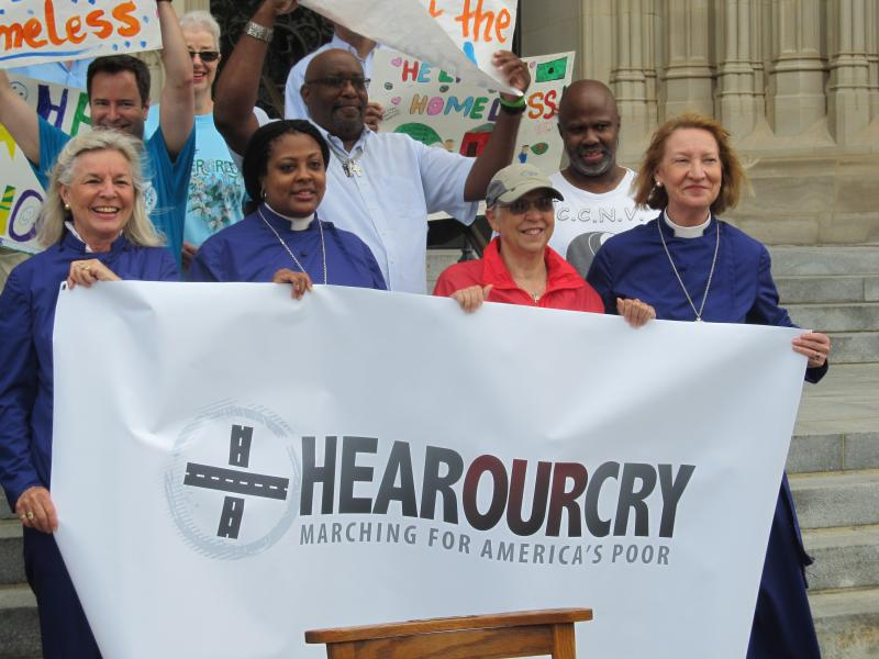 Lou Ness is greeted by supporters and members of the Washington National Cathedral on June 19, 2014