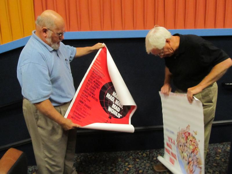 Ed Finch and Alan Wenzel with promotional posters for one of the films showing during the Spencer Tracy film festival