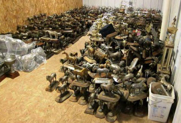 Some of the more than 500 horse-shaped trophies available through the U.S. Marshals Service auction.