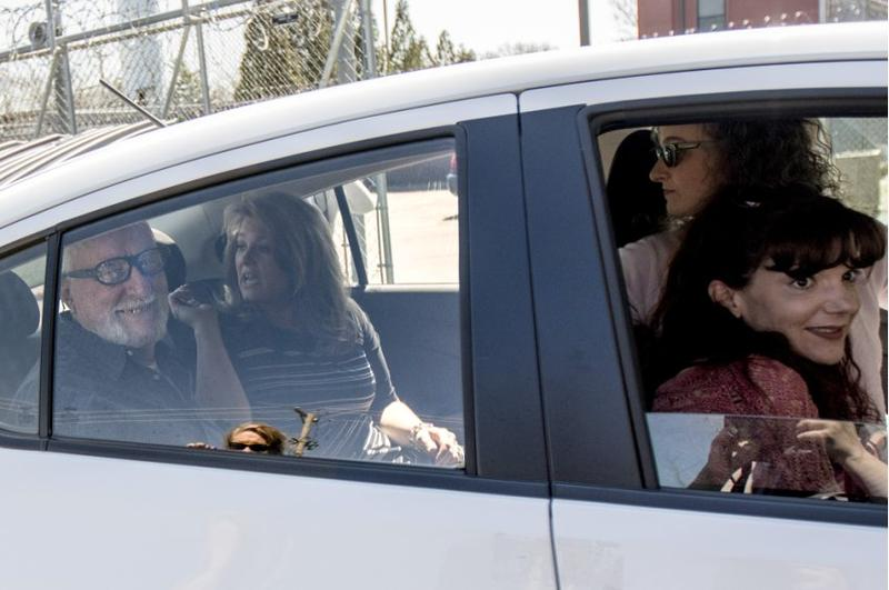 Free after 57 months in custody, Jack McCullough rides away from the DeKalb County jail with friends and family.