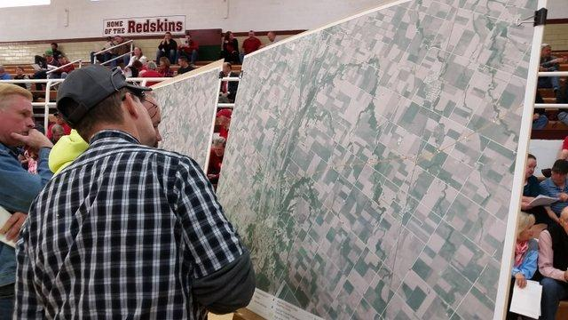 Residents examine maps of the proposed Great Lakes Basin Railroad route at Morris High School.