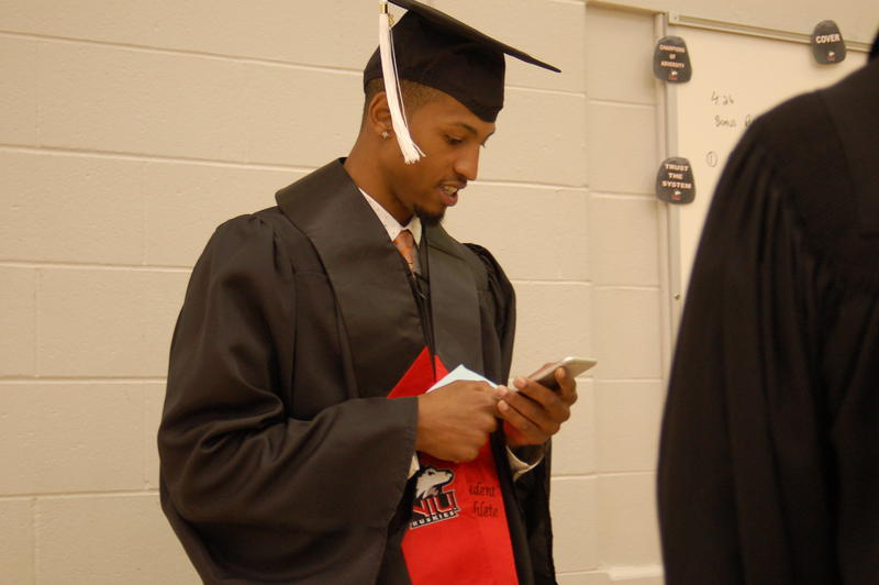 NIU basketball player and corporate communications major Darrell Bowie waits for the commencement ceremonies to begin.