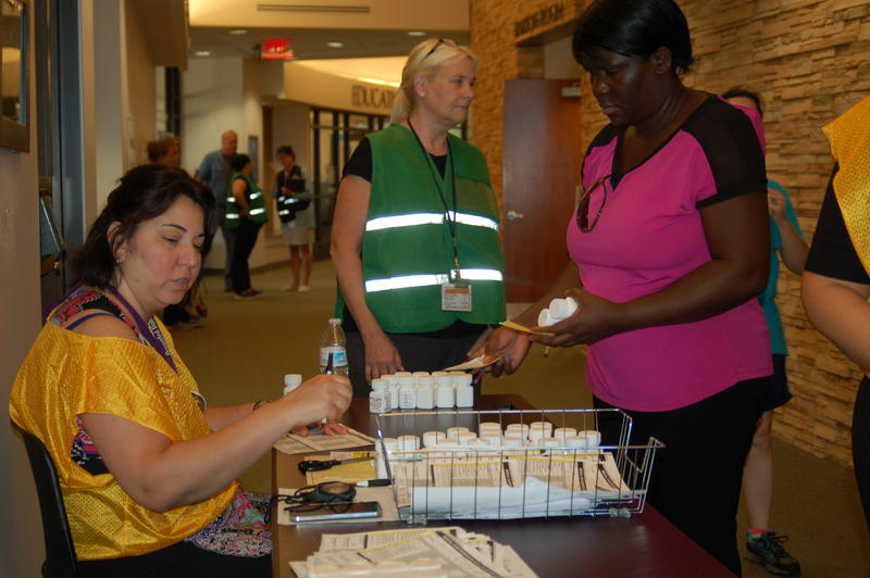 Volunteers help during the state-wide mass distribution test, which involved the DeKalb County Health Department.