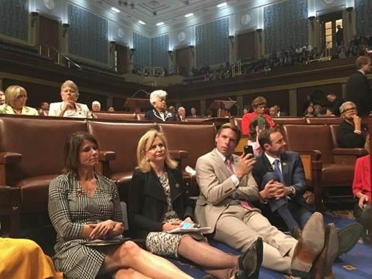 U.S. Rep. Cheri Bustos, of the 17th Illinois District, joined fellow Democratic legislators who sat in on the House floor Wednesday to demand a vote on tighter regulations of firearm sales.