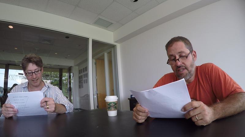 "Dan & Dan at the table reading for ""Politics on Tap"""