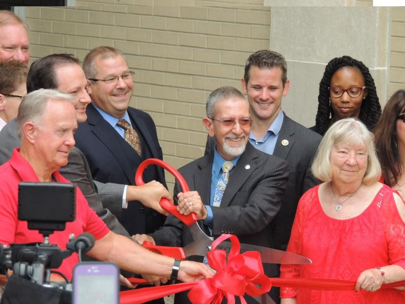 It's official! RVC President Michael Mastrioanni cuts the ribbon at the new RVC Downtown campus Tuesday morning.
