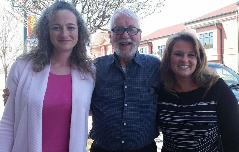 A newly freed Jack McCullough poses on April 15 with his step-daughter, left, and the investigator whose work helped set him free.