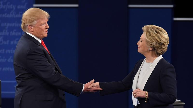 Democratic presidential candidate Hillary Clinton and Republican presidential candidate Donald Trump shake hands at the end of the second presidential debate at Washington University in St. Louis, Mo., on Sunday.
