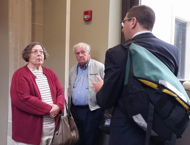 Patricia Ridulph Quinn, sister of the murdered Maria Ridulph, and her husband Bill talk with Exoneration Project attorney Russell Ainsworth  after Thursday's hearing seeking a declaration of innocence for Jack McCullough.
