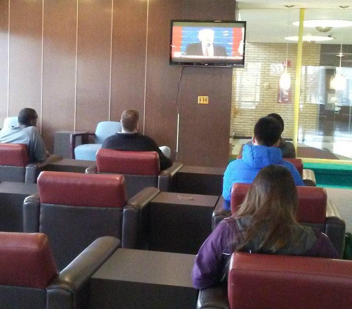Students watch the inauguration in the Holmes Student Center in DeKalb, Ill.