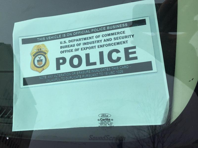 An official parking placard visible inside the windshield of a car parked in front of Caterpillar headquarters on Adams Street in downtown Peoria today.