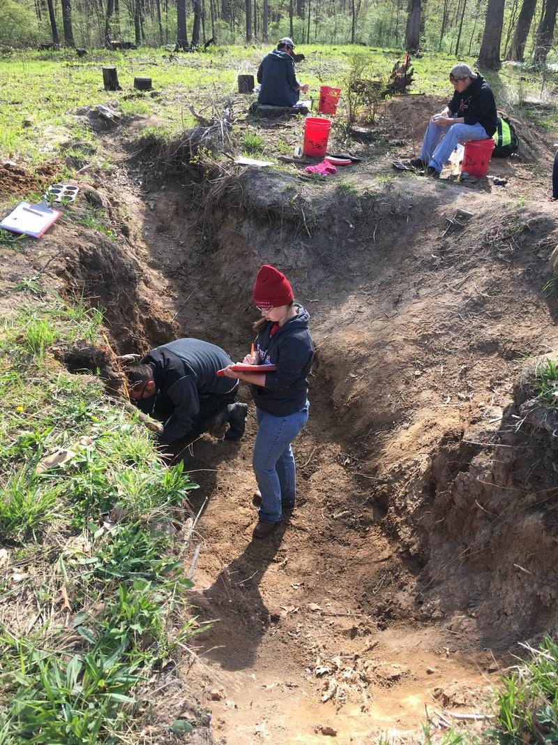 A soil testing team from the University of Arkansas learning to classify soils at Indian Hill Farm near Rockford for the National Soil Testing competition