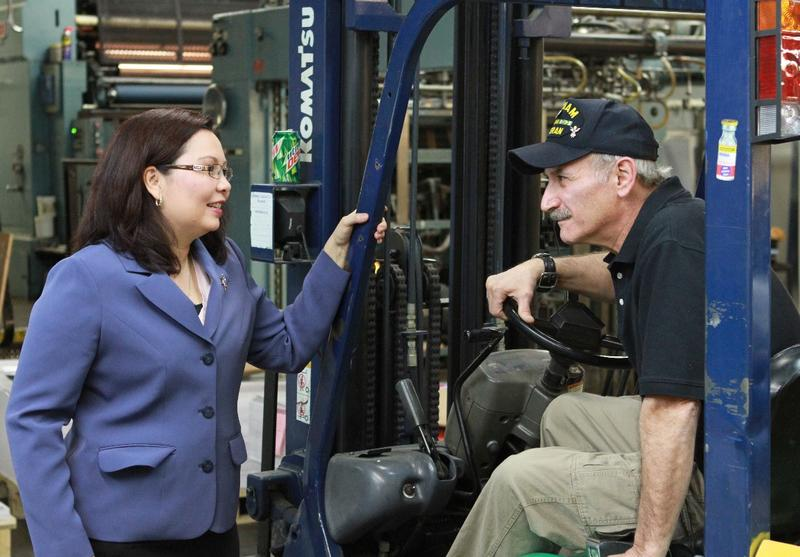 U.S. Sen. Tammy Duckworth talks with a constituent who fits two of her favorite categories: veteran and manufacturing worker.