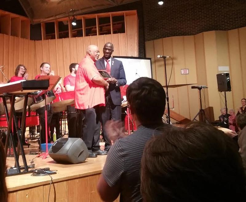 The Hon. Anthony Phillips-Spencer, Ambassador of the Republic of Trinidad and Tobago to the U.S., presents an award to Cliff Alexis at the tribute concert Sunday.