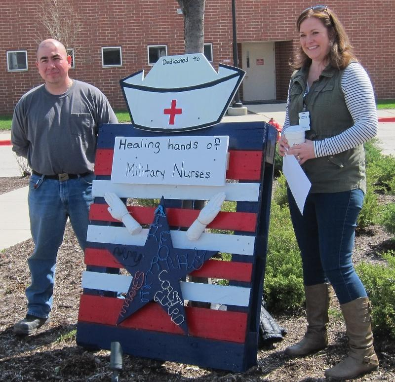 "Veterans who are experienced artists teamed up with staff members at Hines VA hospital to ""adapt a pallet"" as an artistic display with a patriotic theme. This pallet honors military nurses from all branches."