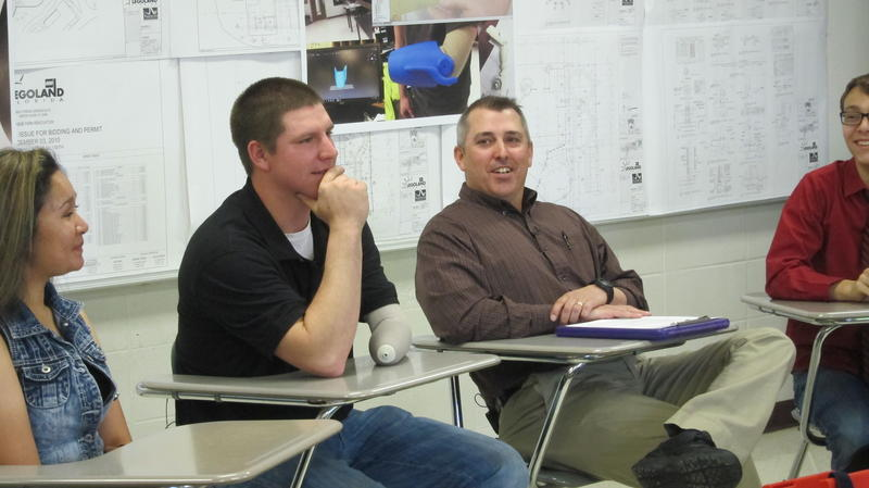Jake Hubbard and Vic Worthington speak to reporters about the prosthesis project.