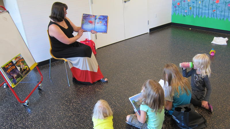 """Gillian King-Cargile reads her second book, """"Toy and the Tide Pool"""" to children at DeKalb Library"""