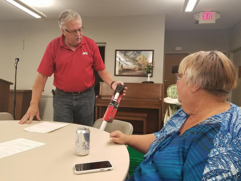 The owner of Ace Hardware in Roscoe shows participants ways to inexpensively guard their homes at a recent presentation in Rockford.
