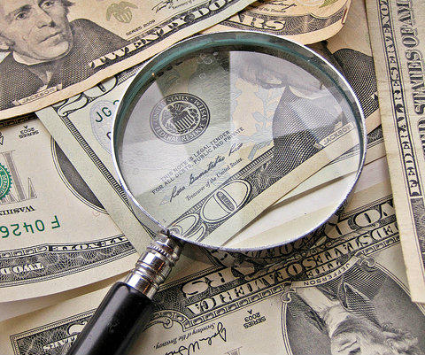 """""""Magnifying Glass and Money"""" / cropped / Flickr user: Images Money (CC BY 2.0) http://bit.ly/2w5JXcQ"""